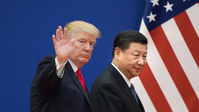 Les présidents américain Donald Trump et chinois Xi Jinping, le 9 novembre 2017 à Pékin [Nicolas ASFOURI / AFP/Archives]