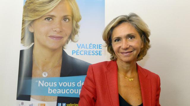 Valerie Pecresse, devant son affiche électorale pour les régionales le 18 septembre 2015 à Paris [BERTRAND GUAY / AFP/Archives]