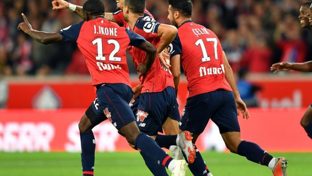 La joie des Lillois après le but de José Fonte (g) face à Nantes, le 22 septembre 2018 à Villeneuve-d'Ascq [DENIS CHARLET / AFP]