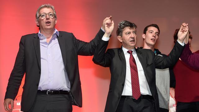 Jean-Luc Mélenchon (à d) co-président du Parti de gauche et Pierre Laurent (à g), secrétaire du Parti communiste le 20 mai 2014 à Toulouse lors d'un meeting [Eric Cabanis / AFP/Archives]