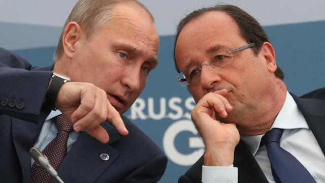 Le président russe Vladimir Poutine et le président français François Hollande lors du sommet du G20 à Saint-Pétersbourg, en Russie, le 6 septembre 2013 [Tatyana Zenkevich / Pool/AFP/Archives]