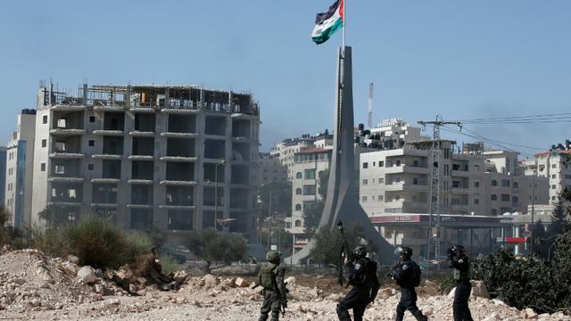Des forces de sécurité israélienne près de la colonie de Beit El en Cisjordanie occupée, le 11 octobre 2015 [ABBAS MOMANI / AFP/Archives]