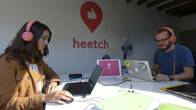 Des employés de Heetch au siège de l'entreprise à Paris, le 10 septembre 2015 [BERTRAND GUAY / AFP]