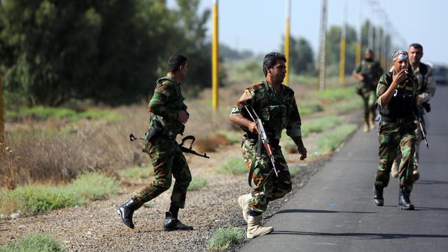 Des volontaires chiites prêts à affronter des jihadistes qui ont  pris le contrôle de zones dans la ville de Samarra, le 12 juillet 2014  [Ahmad al-Rubaye / AFP/Archives]