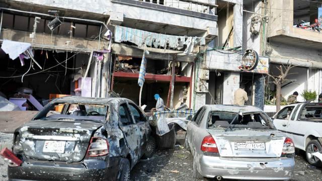 Photo remise par l'agence de presse officielle syrienne, Sana, montrant les suites d'un double attentat suicide à Homs, le 26 janvier 2016 [STRINGER / SANA/AFP]