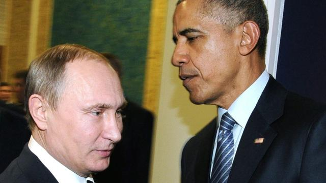 Le président russe Vladimir Poutine et le président américain, Barack Obama à la CPO21 de Paris, le 30 novembre 2015 [MIKHAIL KLIMENTYEV / SPUTNIK/AFP]