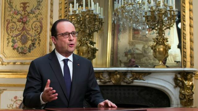 François Hollande adresse ses  voeux aux Français le 31 décembre 2014 à l'Elysée à Paris [IAN LANGSDON / POOL/AFP/Archives]