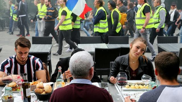 """Des manifestants """"gilets jaunes"""" défilent, le 18 mai 2019 à Reims [FRANCOIS NASCIMBENI / AFP]"""