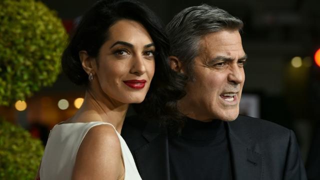 """George Clooney et son épouse Amal à l'avant-première de """"Ave César"""" le 1er février 2016 à Westwood, en Californie [Valerie Macon / AFP]"""