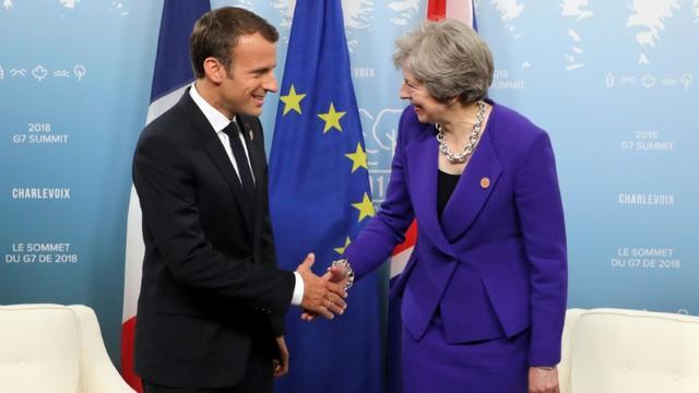 Le président français Emmanuel Macron et la Première ministre britannique Theresa May, lors du G7 à La Malbaie, au Québec, le 8 juin 2018 [ludovic MARIN / AFP/Archives]