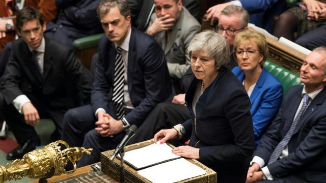La Première ministre britannique Theresa May, sur une photographie transmise par le Parlement, lors du vote sur l'accord avec l'Union européenne le 15 janvier 2019. [Mark DUFFY / UK PARLIAMENT/AFP]