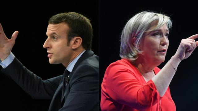 Photomontage du 30 avril 2017 présentant le candidat centriste Emmanuel Macron (G) à l'élection présidentielle et la candidate d'extrême droite Marine Le Pen (D)  [Eric FEFERBERG, ALAIN JOCARD / AFP/Archives]