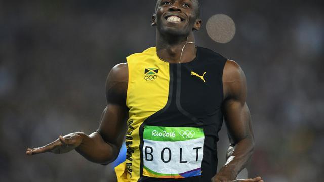 Usain Bolt médaillé d'or olympique à Rio, le 14 août 2016 [Johannes EISELE / AFP]