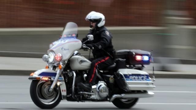 Un motard de la police dans les rues d'Ottawa au Canada, le 22 octobre 2014 [MIKE CARROCCETTO / Getty/AFP/Archives]