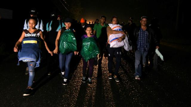 Des migrants honduriens en route pour les Etats-Unis, le 14 janvier 2019 à San Pedro Sula [ORLANDO SIERRA / AFP]