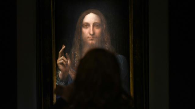 Le tableau du peintre italien Léonard de Vinci adjugé 450,3 millions de dollars photographié le 3 novembre 2017 à New York [TIMOTHY A. CLARY / AFP/Archives]