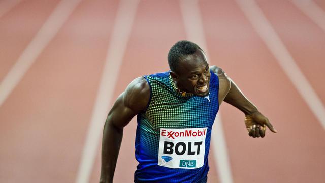 Le Jamaïcain Usain Bolt à l'arrivée du 200 m de la réunion d'Oslo le 13 juin 2013 au Bislett Stadium [Vegard Grott / NTB SCANPIX/AFP/Archives]
