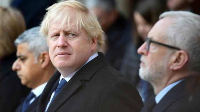 De G à D, le maire de Londres Sadiq Khan, le Premier ministre britannique Boris Johnson et le chef du Labour Jeremy Corbyn participent le 2 décembre 2019 à Londres à un hommage aux victimes de l'attentat de London Bridge [DANIEL LEAL-OLIVAS / AFP]