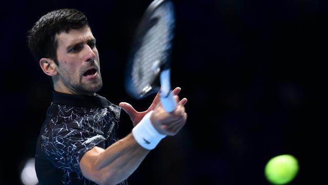Le Serbe Novak Djokovic face à l'Allemand Alexander Zverev au Masters, le 14 novembre 2018 à Londres [Glyn KIRK                   / AFP]