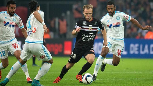 L'attaquant de Nice Valère Germain (c) contre Marseille, le 8 novembre 2015 au Stade Vélodrome  [Bertrand Langlois / AFP]