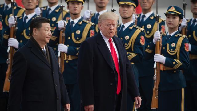 Donald Trump et Xi Jinping le 7 novembre 2017 à Pékin [NICOLAS ASFOURI / AFP/Archives]