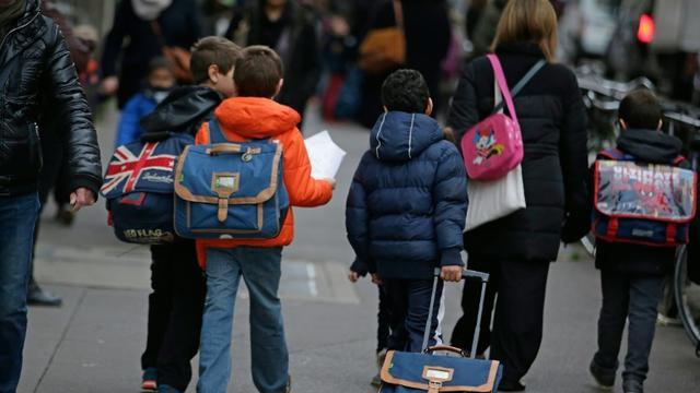 Des enfants partent à l'école le 16 novembre 2015 à Paris  [KENZO TRIBOUILLARD / AFP/Archives]