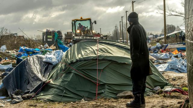 """Démantèlement du camp de migrants la """"Jungle"""" le 3 mars 2016 à Calais [PHILIPPE HUGUEN / AFP/Archives]"""