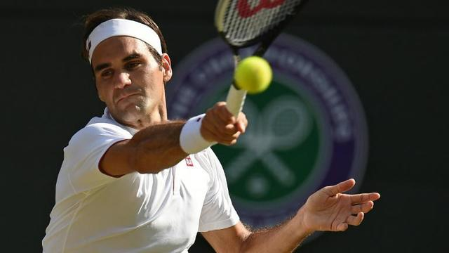 Le Suisse Roger Federer face au Sud-Africain Kevin Anderson en quarts de finale de Wimbledon, le 11 juillet 2018 [Oli SCARFF                           / AFP]