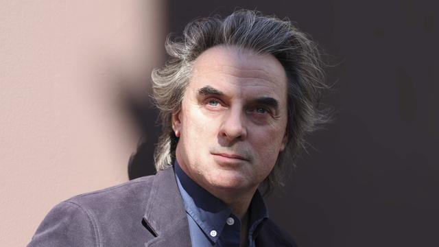 """Jean-Christophe Grangé est notamment l'auteur des """"Rivières pourpres"""" et """"Du Concile de Pierre"""", deux ouvrages adaptés au cinéma."""