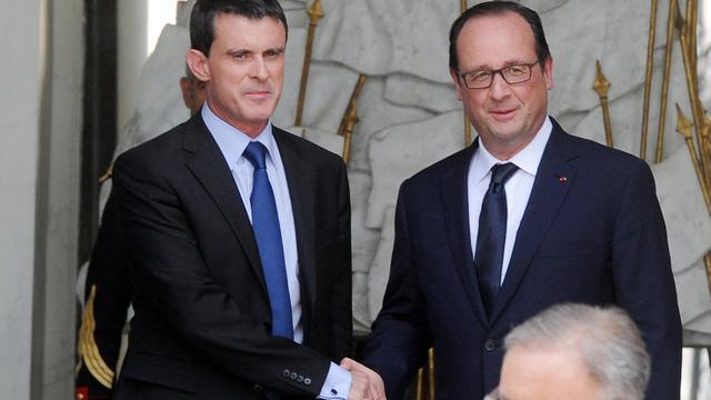 François Hollande et Manuel Valls à la sortie du dernier séminaire gouvernemental avant la pause estivale, le 1er août 2014 au Palais de l'Elysée [Dominique Faget / AFP / Archives]