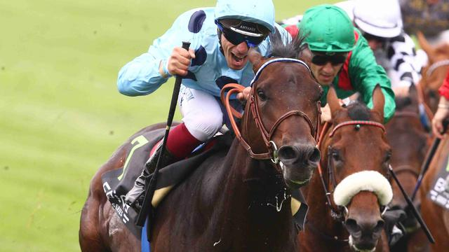 Almanzor et le jockey J.B. Eyquem ont remporté le Prix du Jockey Club, l'année dernière.
