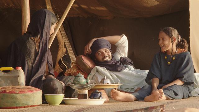 "Toulou Kiki, Ibrahim Ahmed dit Pino et Layla Walet Mohamed dans le film ""Timbuktu"" de Abderrahmane Sissako."